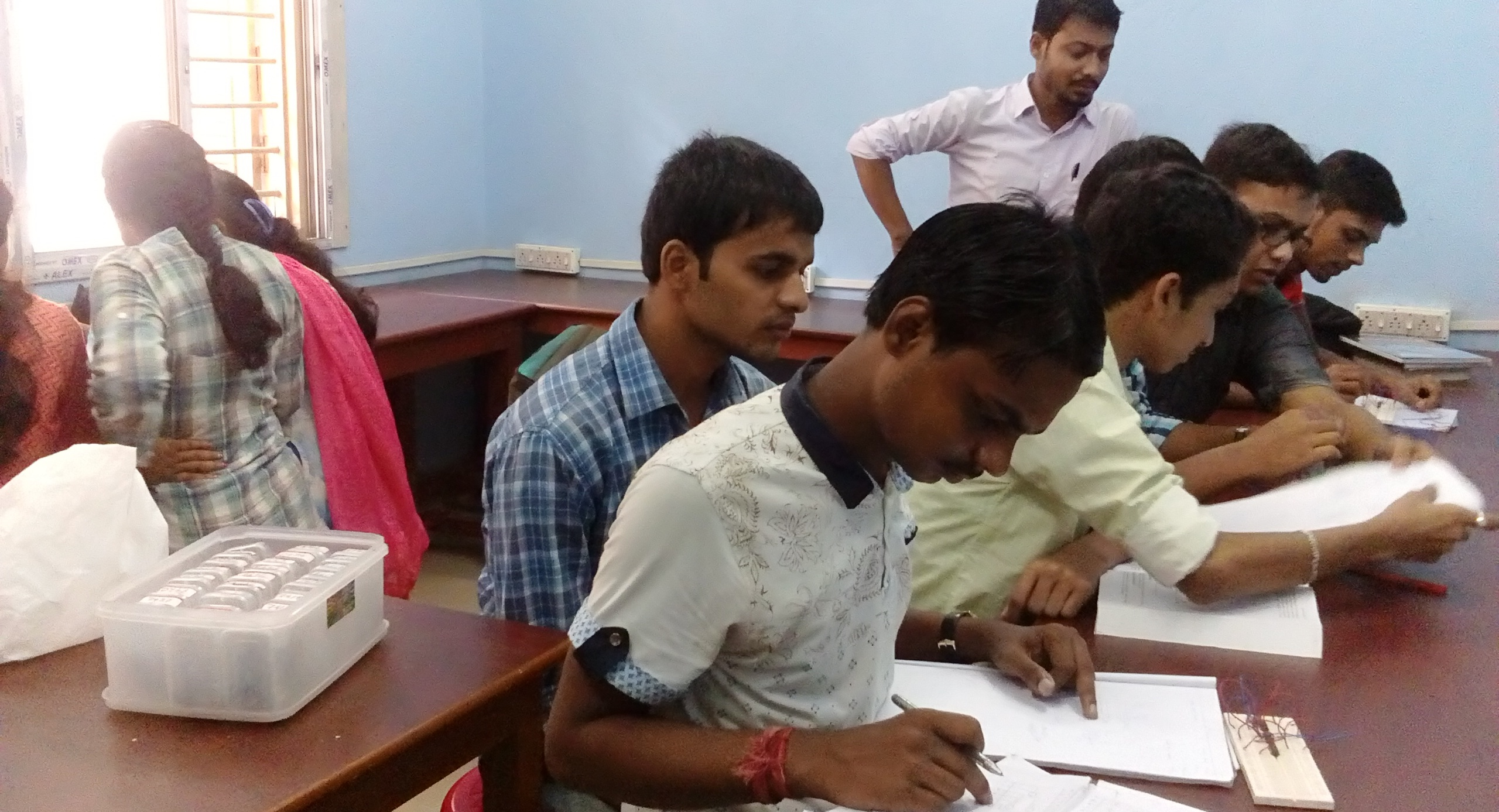Students are doing hardware practical under the guidence of faculty
